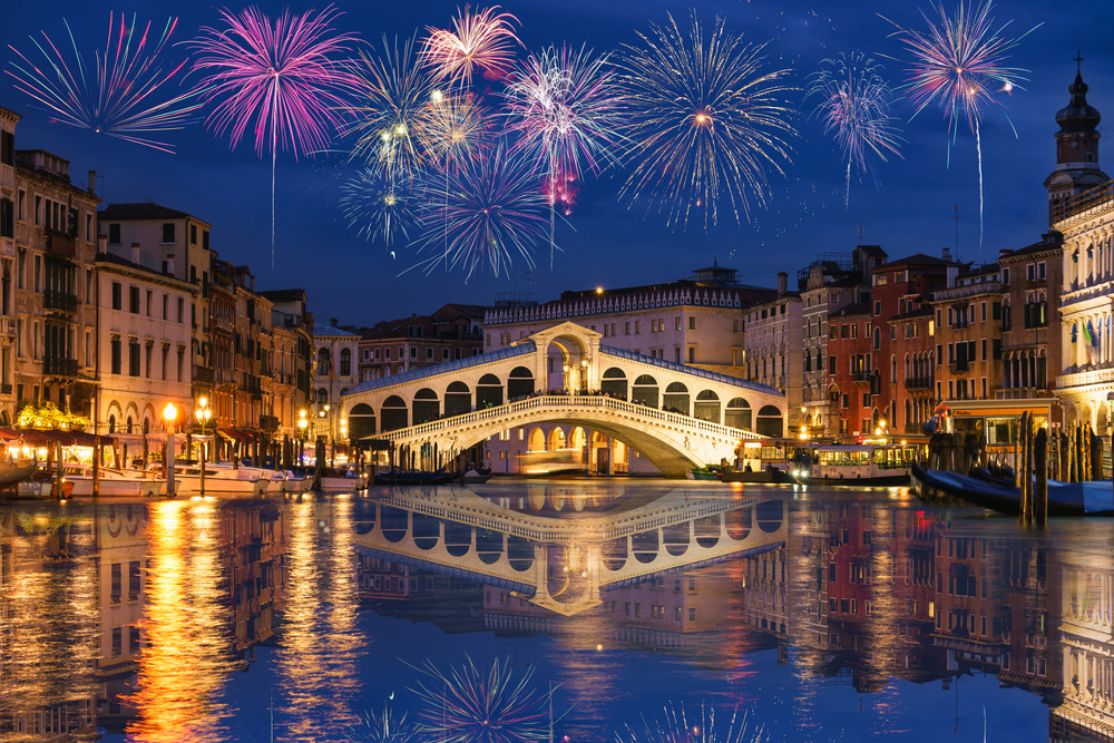 Fireworks over the Rialto Bridge and Grand Canal, New Year's Eve, Venice, Italy
