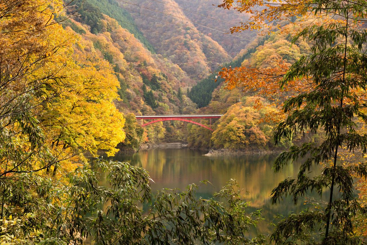 Lake Okutama and Kouran bridge in autumn, Tokyo, Japan.