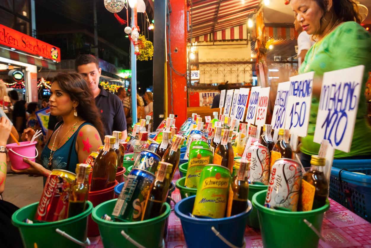 Bucket drinks during a Full Moon party, Ko Phangan, Thailand