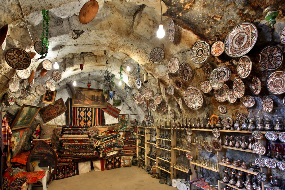 Underground shop, Derinkuyu entrance, Cappadocia, Turkey. Heracles Kritikos/Shutterstock.com