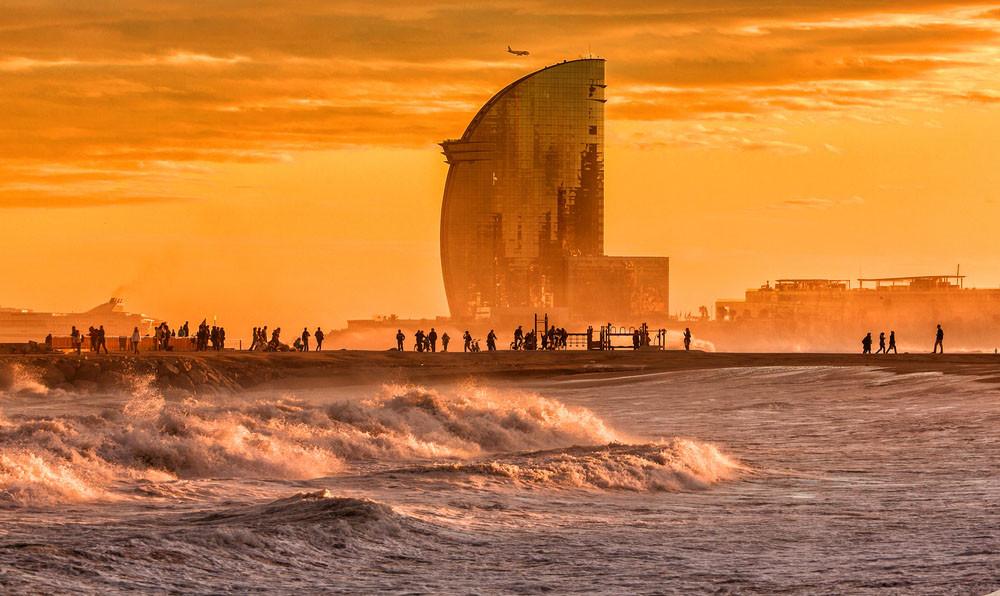 Sunset at Barceloneta Beach, Barcelona, Spain.