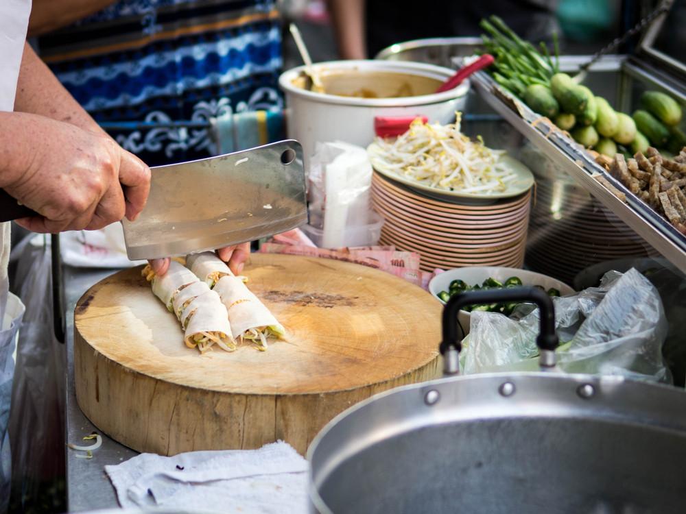 Making spring rolls, Vietnam.