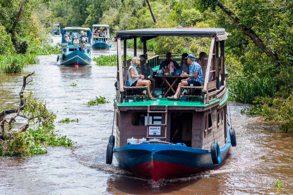 Local 'klotok' boat on Sekonyer River into Tanjung Puting Jungle, Borneo, Indonesia.